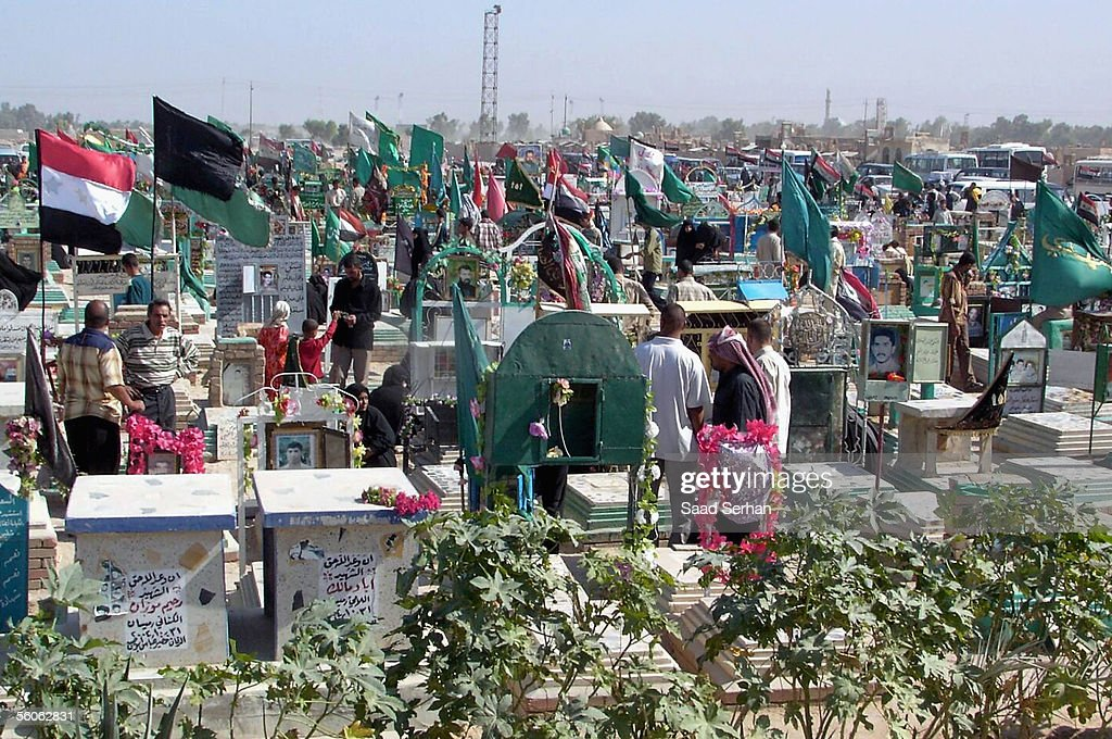 Iraqis visit Najaf cemetery in the first day of Eid al-Fitr holiday on November 3, 2005 in the holy Shiite city of Najaf, Iraq.