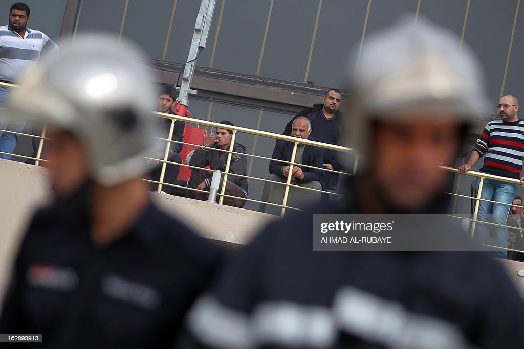 Iraqi's wait to retrieve the bodies of their relatives on March 1, 2013 after the sinking of a floating restaurant belonging to the Lebanese Club in Baghdad. A floating restaurant moored on the bank of Baghdad's Tigris River sank on February 28, during a private party with 150 people on board, leaving five people dead, Iraqi officials said.
