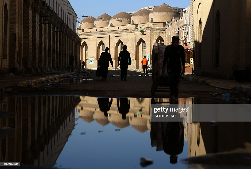 Iraqis walk in the old Ottoman neighbourhood of Baghdad on February 3, 2013.