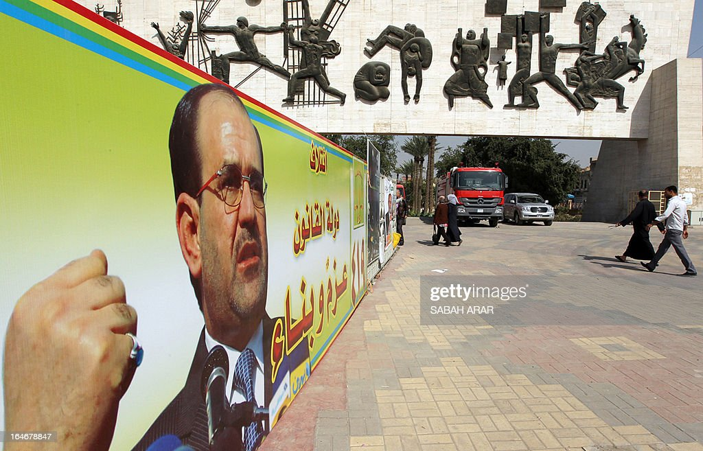 Iraqis walk past an electoral campaign banner showing Iraqi Prime Minister Nuri al-Maliki in Baghdad on March 25, 2013. Baghdad and much of Iraq has been plastered with posters, ranging from the ordinary to the bizarre, of election candidates vying for voters' attention ahead of provincial elections next month. Judging by the slogans and appeals on many of the posters, analysts and commentators note, Iraqi political campaigning still has a long way to go, with most making no mention of ideology or policies and many not even featuring the candidate running for office.