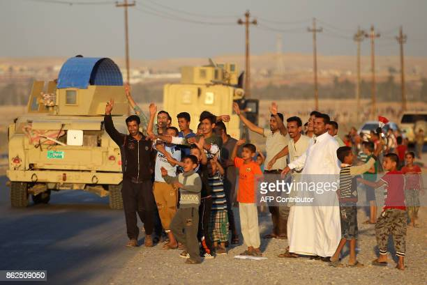 Iraqis welcome Iraqi soldiers entering the city of Kirkuk on October 17 2017 Kurdish peshmerga forces withdrew without a fight after federal...