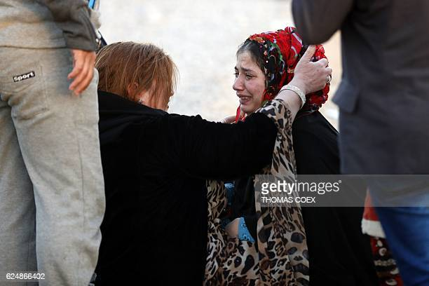 Iraqis who were separated by the ongoing fighting cry and hug their relatives as they meet after a long time at the Khazir refugee camp near the...