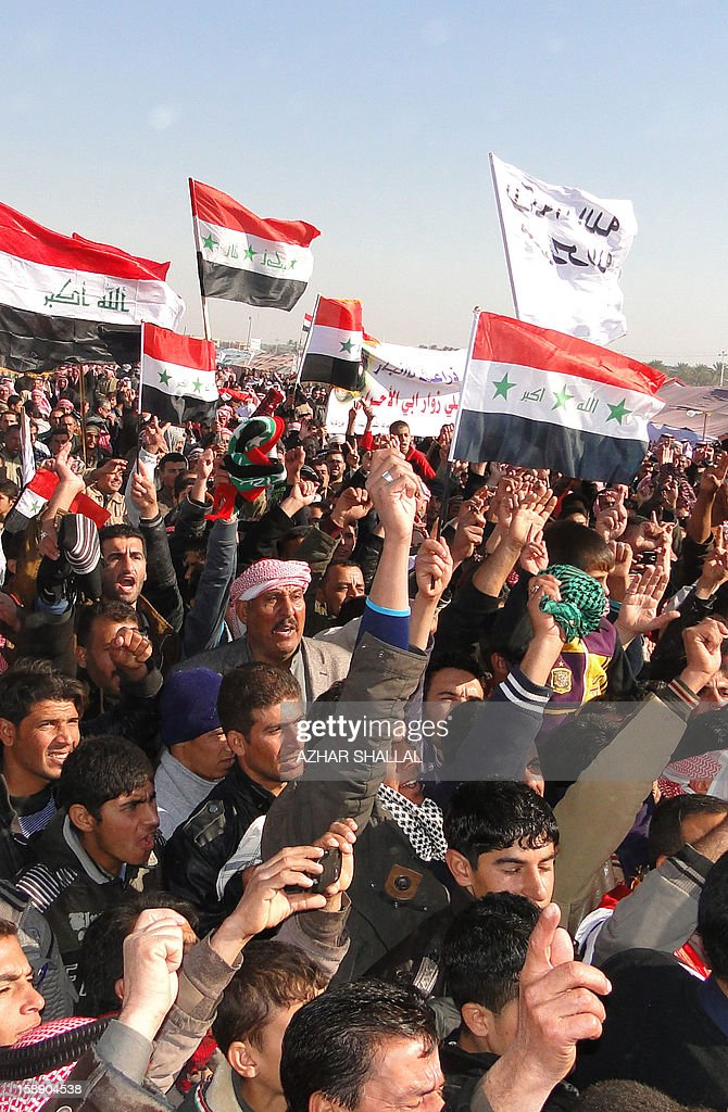 Iraqi-Sunni protestors and Shiite demonstrators from the Karbala provinces and the Baghdad Shiite suburb of Sadr City shout slogans during a demonstration in the western city of Ramadi calling for the release of prisoners and the resignation of the Iraqi Shiite premier on January 3, 2013. Officials sought to head off the demonstrations against Iraqi Prime Minister, Nuri al Malaki, by beginning a mass release of female prisoners, a key demand of Sunni Arab protesters angered by what they allege is the misuse of anti-terror legislation by the Shiite-led authorities to target their minority community.