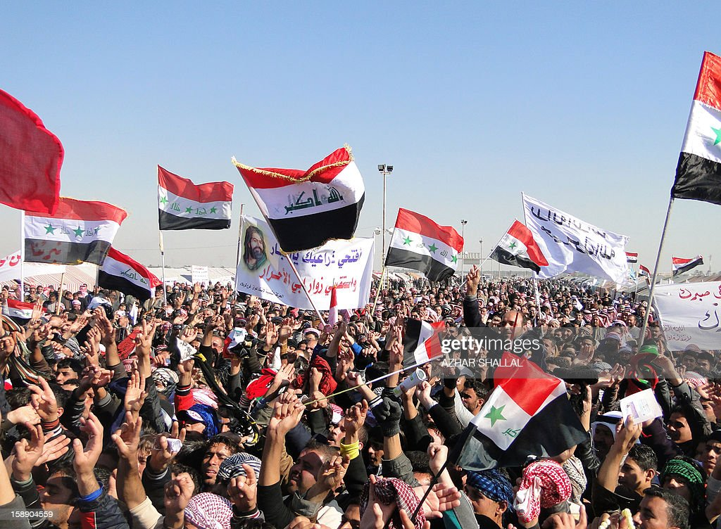 Iraqi-Sunni protestors and Shiite demonstrators from the Karbala provinces and the Baghdad Shiite suburb of Sadr City shout anti-government slogans during a demonstration in the western city of Ramadi calling for the release of prisoners and the resignation of the Iraqi Shiite premier on January 3, 2013. Officials sought to head off the demonstrations against Iraqi Prime Minister, Nuri al Malaki, by beginning a mass release of female prisoners, a key demand of Sunni Arab protesters angered by what they allege is the misuse of anti-terror legislation by the Shiite-led authorities to target their minority community.