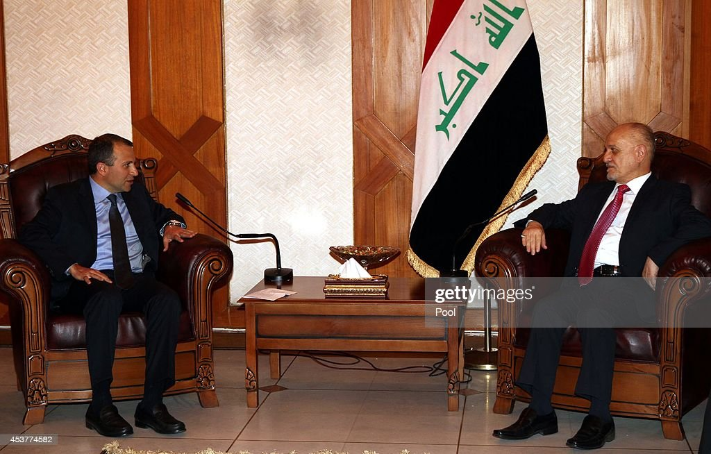 Iraq's acting Foreign Minister Hussein Shahristani (R) meets with Lebanon's Foreign Minister Jebran Bassil (L) at his office on August 18, 2014 in Baghdad, Iraq. Bassil visited Baghdad to hold talks with senior Iraqi officials about the latest development in the area , and express his solidarity with Iraq in its war against the terrorism .