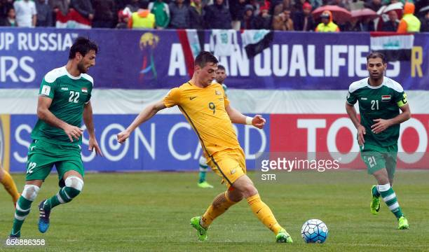 Iraq's defender Rebin Sulaka and midfielder Saad AbdulAmir mark attempts a tackle on Australia's forward Tomi Juric during the FIFA World Cup 2018...