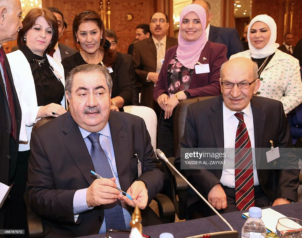 Iraq's Finance Minister <a gi-track='captionPersonalityLinkClicked' href=/galleries/search?phrase=Hoshyar+Zebari&family=editorial&specificpeople=227333 ng-click='$event.stopPropagation()'>Hoshyar Zebari</a> (L) and Iraqi Central Bank's governor Sinan al-Shabibi attend a meeting of Arab Financial Institutions on April 7, 2015 in Kuwait City. AFP PHOTO / YASSER AL-ZAYYAT