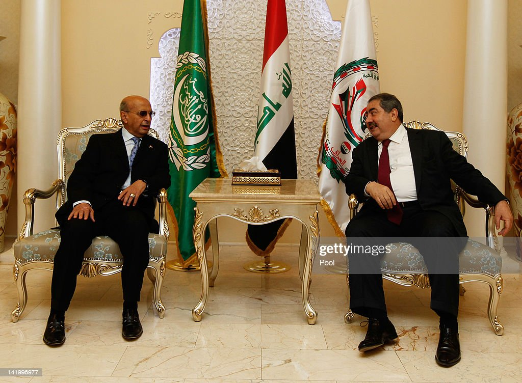 Iraq's Foreign Minister <a gi-track='captionPersonalityLinkClicked' href=/galleries/search?phrase=Hoshyar+Zebari&family=editorial&specificpeople=227333 ng-click='$event.stopPropagation()'>Hoshyar Zebari</a> (R) meets with his Yemeni counterpart Abubakr al-Qirbi upon his arrival for the Arab foreign minister's meeting as part of the Arab League Summit on March 28, 2012 in Baghdad, Iraq.