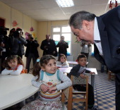 Iraq's Foreign Minister Hoshyar Zebari talks to refugee children during his visit the refugee camp following the second round of ministerial meeting...