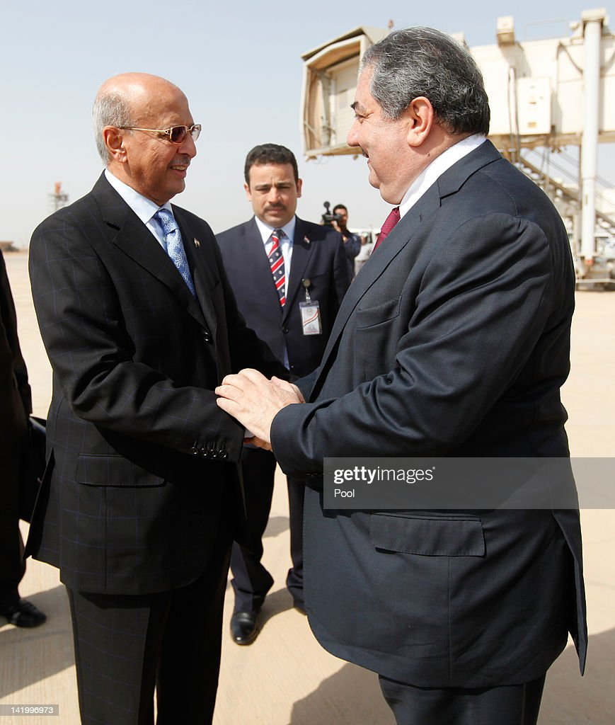 Iraq's Foreign Minister <a gi-track='captionPersonalityLinkClicked' href=/galleries/search?phrase=Hoshyar+Zebari&family=editorial&specificpeople=227333 ng-click='$event.stopPropagation()'>Hoshyar Zebari</a> (R) welcomes his Yemeni counterpart Abubakr al-Qirbi upon his arrival for the Arab foreign minister's meeting as part of the Arab League Summit on March 28, 2012 in Baghdad, Iraq.