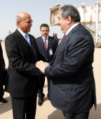 Iraq's Foreign Minister Hoshyar Zebari welcomes his Yemeni counterpart Abubakr alQirbi upon his arrival for the Arab foreign minister's meeting as...