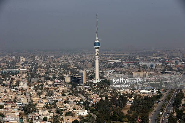 Iraq's Mamoun Tower iis seen as US Secretary of Defense Chuck Hagel's helicopter flies over the city December 9 2014 in Baghdad Iraq Secretary Hagel...