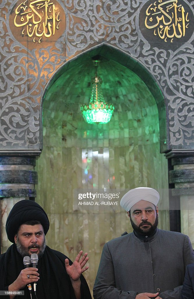 Iraq's maverick Shiite cleric Muqtada al-Sadr (L) addresses worshippers during Friday prayers in which Sunni and Shiite Muslims took part together in a gesture of unity at the Abdul Qadir Gilani Mosque in Baghdad on January 4, 2013, as protests in Sunni-majority areas across the country were planned to call for the release of prisoners and criticise Nuri al-Maliki's Shiite-led government.
