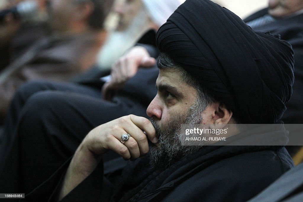 Iraq's maverick Shiite cleric Muqtada al-Sadr takes part in Friday prayers attended by Sunni and Shiite Muslim worshippers in a gesture of unity at the Abdul Qadir Gilani Mosque in Baghdad on January 4, 2013, as protests in Sunni-majority areas across the country were planned to call for the release of prisoners and criticise Nuri al-Maliki's Shiite-led government.