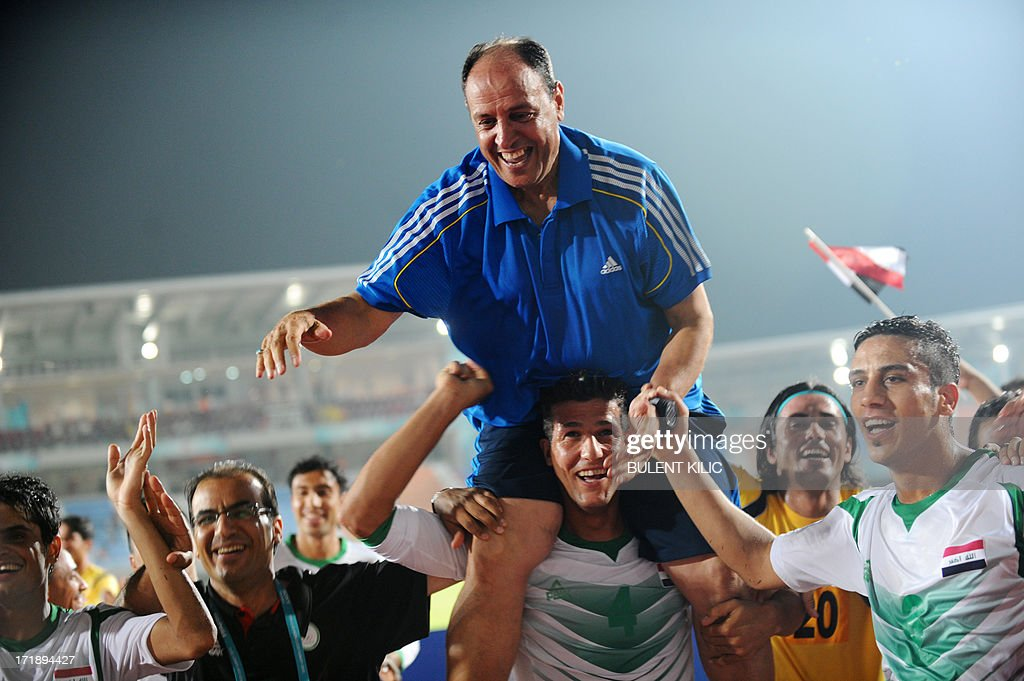 Iraq`s players and their head coach Hakeem Al Azzawi (C) celebrate their victory at the end of a group stage football match Iraq vs Chile at the FIFA Under 20 World Cup at Akdeniz University Stadium in Antalya on June 29, 2013.