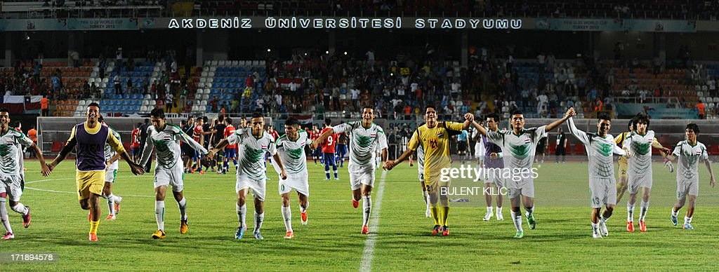 Iraq`s players celebrate their victory after a group stage football match between Iraq and Chile at the FIFA Under 20 World Cup at Akdeniz University Stadium in Antalya on June 29, 2013.