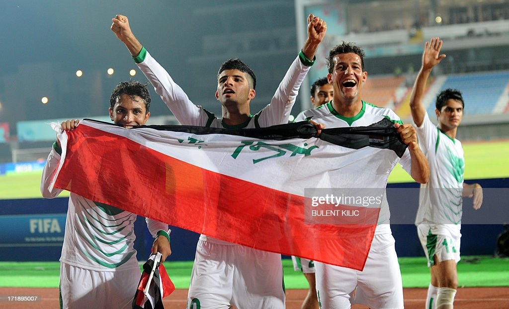 Iraq's players celebrate their victory over Chile during a group stage football match between Iraq and Chile at the FIFA Under 20 World Cup at Akdeniz University Stadium in Antalya on June 29, 2013.