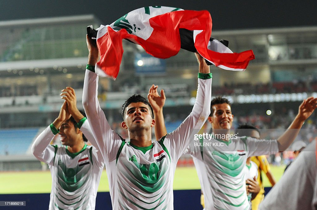 Iraq's players celebrate their victory over Chile during a group stage football match between Iraq and Chile at the FIFA Under 20 World Cup at Akdeniz University Stadium in Antalya on June 29, 2013. AFP PHOTO / BULENT KILIC
