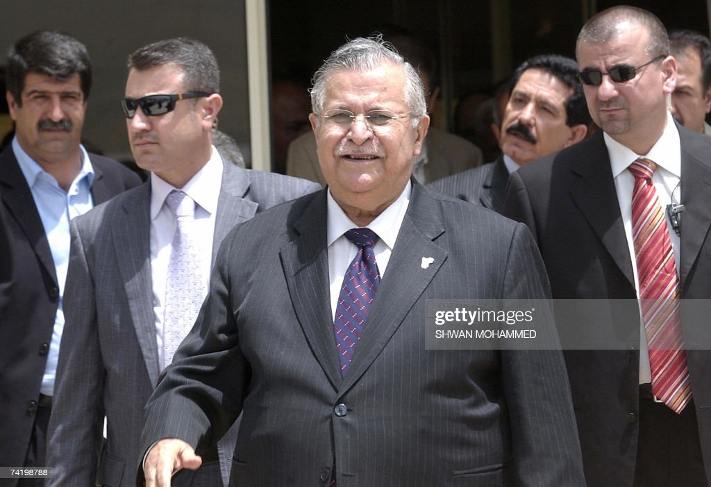 Iraq's President Jalal Talabani is surrounded by security as he prepares to board a plane in the northern town of Suleimaniya 20 May 2007 Talabani...