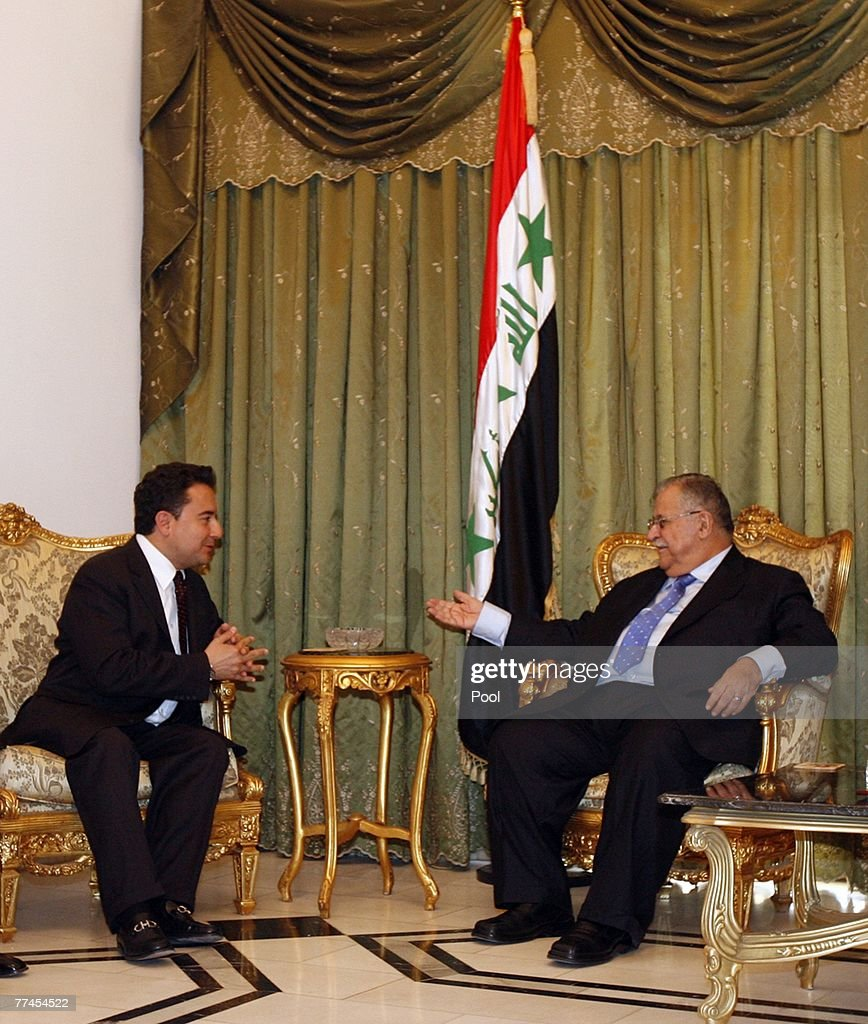 Iraq's President <a gi-track='captionPersonalityLinkClicked' href=/galleries/search?phrase=Jalal+Talabani&family=editorial&specificpeople=213582 ng-click='$event.stopPropagation()'>Jalal Talabani</a> (R) talks to Turkish Foreign Minister <a gi-track='captionPersonalityLinkClicked' href=/galleries/search?phrase=Ali+Babacan&family=editorial&specificpeople=612964 ng-click='$event.stopPropagation()'>Ali Babacan</a> during a meeting on October 23, 2007 in Baghdad, Iraq. Babacan rejected any cease-fire declared by rebels from the Kurdistan Workers' Party (PKK) as the buildup of Turkish troops continued on the Iraqi-Turkish border.