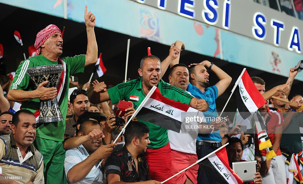 Iraq's supporters celebrate the victory of their team at the end of a group stage football match Iraq vs Chile at the FIFA Under 20 World Cup at Akdeniz University Stadium in Antalya on June 29, 2013 at the end of a group stage football match Iraq vs Chile at the FIFA Under 20 World Cup at Akdeniz University Stadium in Antalya on June 29, 2013.
