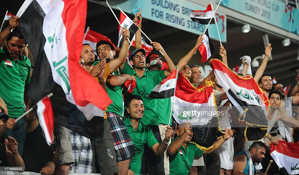 Iraq's supporters celebrate the victory of their team over Chile during a group stage football match between Iraq and Chile at the FIFA Under 20 World Cup at Akdeniz University Stadium in Antalya on June 29, 2013. AFP PHOTO / BULENT KILIC