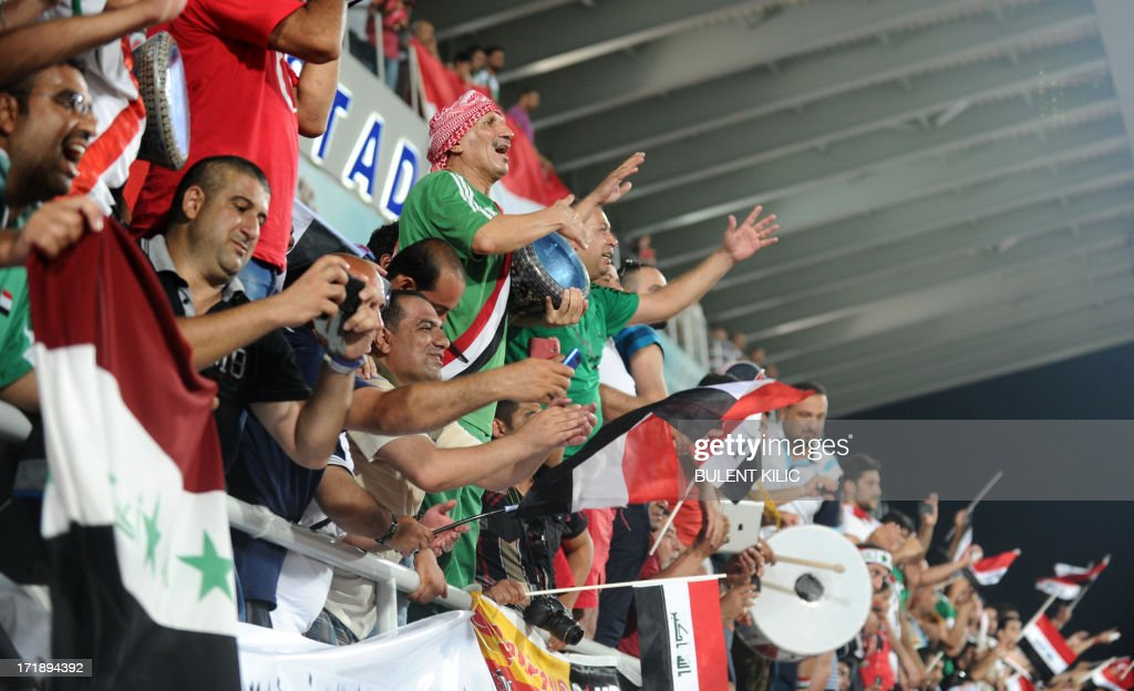 Iraq's supporters celebrate the victory og their team at the end of a group stage football match Iraq vs Chile at the FIFA Under 20 World Cup at Akdeniz University Stadium in Antalya on June 29, 2013. AFP PHOTO / BULENT KILIC