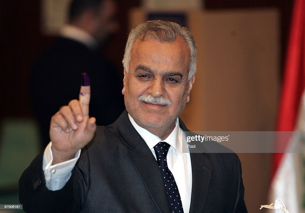 Iraq's Vice President Tareq al-Hashimi shows his ink marked finger after casting his vote for the Iraqi parlaimentary elections, in a polling station in the green zone on March 07, 2010 in Baghdad, Iraq. People in 18 Iraqi provinces have started voting, in the second parliamentary election since the US overthrow of Saddam Hussein in 2003, to choose their candidates for the 325-seat parliament at about 10,000 polling centers.