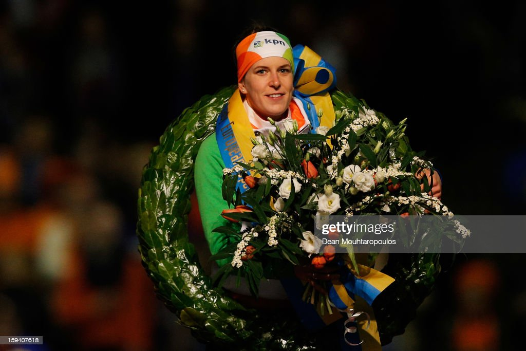 Ireen Wust of Netherlands celebrates becoming the European Champion with her medal, wreath and flowers during the Final Day of the Essent ISU European Speed Skating Championships 2013 at Thialf Stadium on January 13, 2013 in Heerenveen, Netherlands.