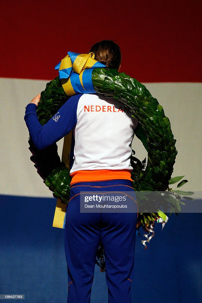 Ireen Wust of Netherlands celebrates becoming the European Champion with her medal, wreath and flowers and stands for the national anthem during the Final Day of the Essent ISU European Speed Skating Championships 2013 at Thialf Stadium on January 13, 2013 in Heerenveen, Netherlands.