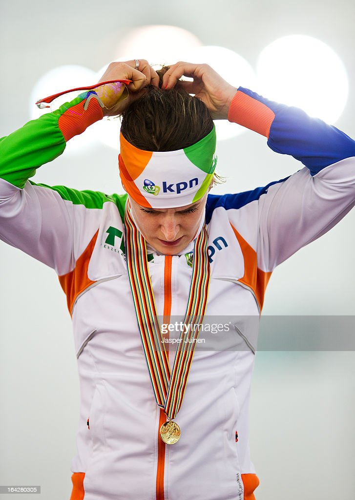 Ireen Wust of the Netherlands adjust her headband, with her golden medal hanging arround her neck, during the podium ceremony of the 1500m race where she won gold on day two of the Essent ISU World Single Distances Speed Skating Championships at the Adler Arena Skating Center on March 22, 2013 in Sochi, Russia.