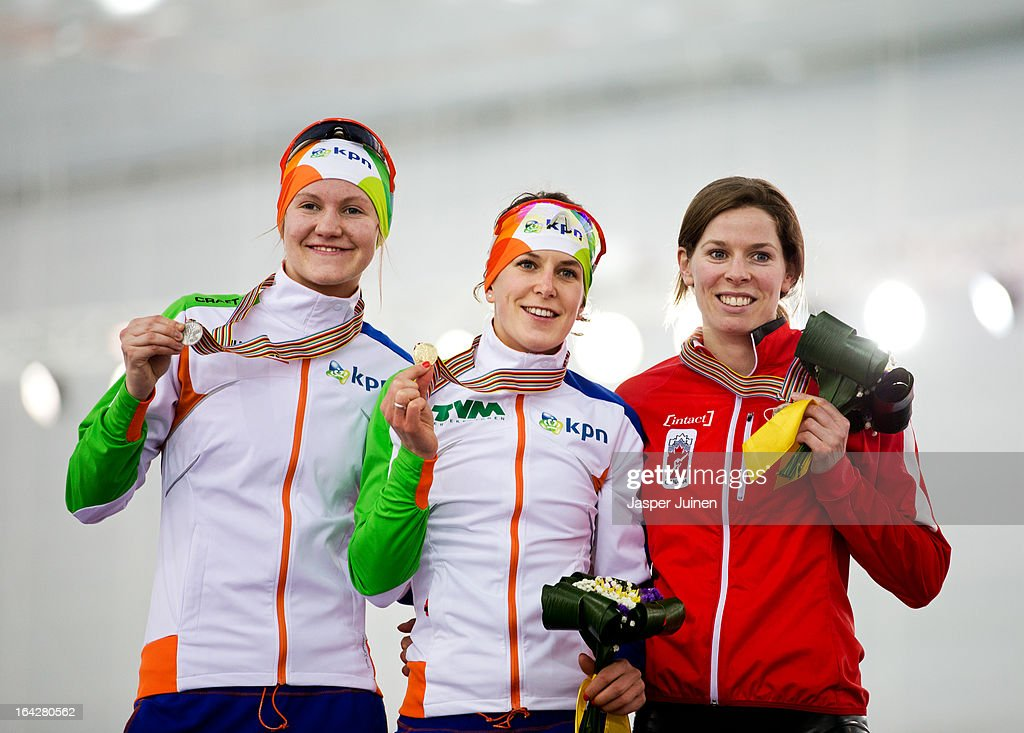 Ireen Wust (C) of the Netherlands shows her golden medal in between Lotte van Beek, silver, from the Netherlands and Christine Nesbitt, bronze, from Canada during the podium ceremony of the 1500m race on day two of the Essent ISU World Single Distances Speed Skating Championships at the Adler Arena Skating Center on March 22, 2013 in Sochi, Russia.