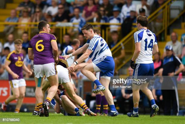 Ireland 8 July 2017 Conor McManus of Monaghan stamping on Jim Rossiter of Wexford and is ultimately shown a black card by referee Conor Lane during...