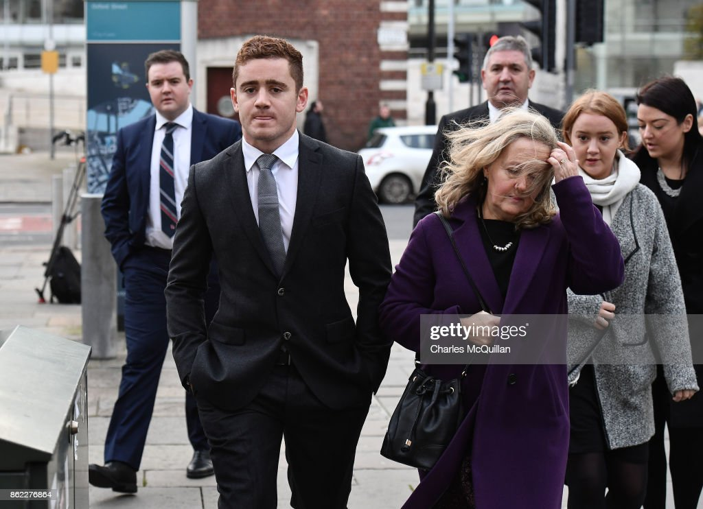 Ireland and Ulster rugby player Paddy Jackson (25) arrives at court with family members at Belfast Magistrates Court relating to a rape charge hearing on October 17, 2017 in Belfast, Northern Ireland. Jackson is charged with one count of rape and one of sexual assualt along with fellow international and provincial team mate Stuart Olding (24) who faces two count of rape charges along with Blane McIlroy (25) and Rory Harrison (25) who are charged with one count of exposure and a count of perverting the course of justice respectively. The charges relate to an aaleged offence committed against a woman at a south Belfast house in June 2016. Jackson has represented his country 25 times while Olding has four caps. The IRFU and Ulster rugby have both stated that the two internationals will play again until court proceedings conclude. All four men deny the charges.