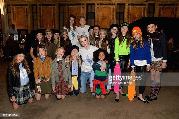 Ireland Baldwin and Gigi Hadid pose with models at the Ralph Lauren Fall 14 Children's Fashion Show in Support of Literacy at New York Public Library...