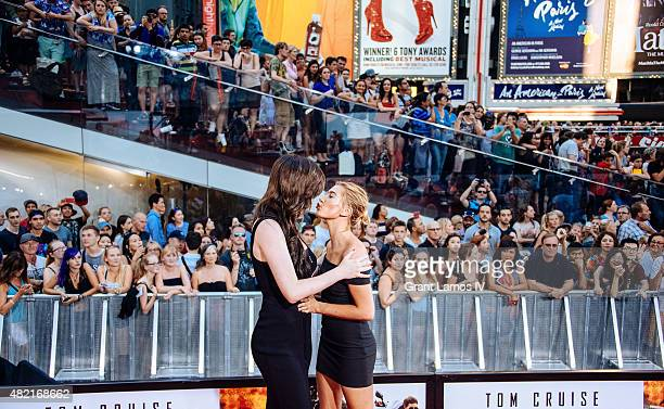 Ireland Baldwin and Hailey Baldwin attend the 'Mission Impossible Rogue Nation' New York Premiere at Duffy Square in Times Square on July 27 2015 in...