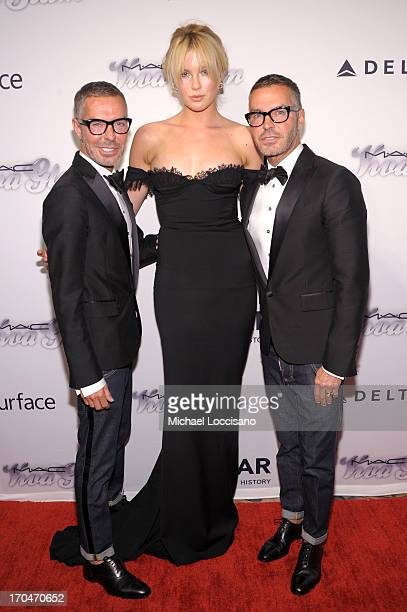 Ireland Baldwin poses with Dean Caten and Dan Caten of Dsquared2 at the 4th Annual amfAR Inspiration Gala New York at The Plaza Hotel on June 13 2013...