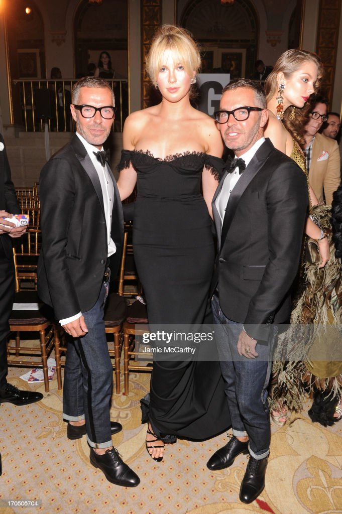 Ireland Baldwin poses with Dean Caten and Dan Caten of Dsquared2 at the 4th Annual amfAR Inspiration Gala New York at The Plaza Hotel on June 13, 2013 in New York City.