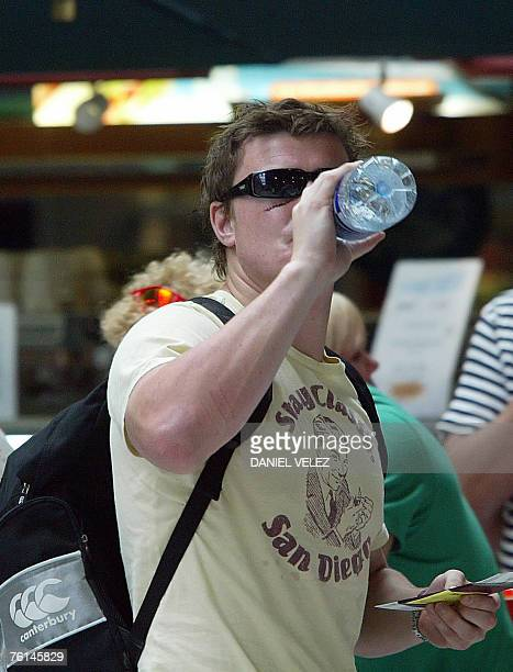 Ireland captain Brian O'Driscoll drinks water prior to taking his flight back to Ireland at the Biarritz airport western France 17 August 2007 Brian...