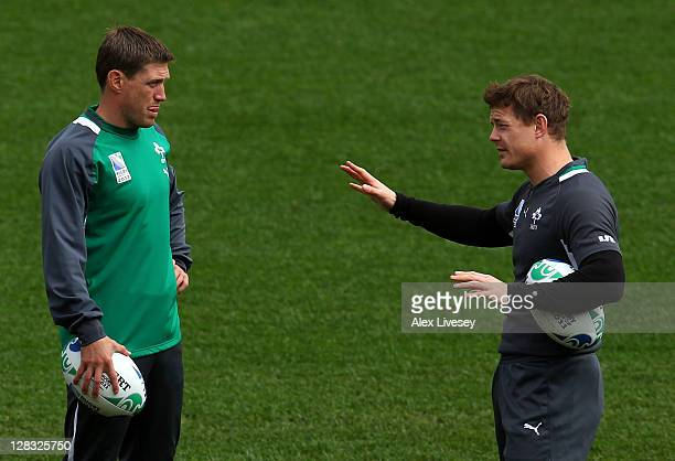 Ireland captain Brian O'Driscoll speaks with flyhalf Ronan O'Gara during an Ireland IRB Rugby World Cup 2011 captain's run at Wellington Regional...