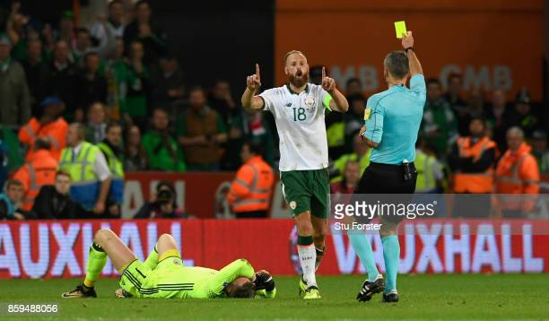 Ireland captain David Meyler recieves a yellow card for a foul on goalkeeper Wayne Hennessey during the FIFA 2018 World Cup Qualifier between Wales...