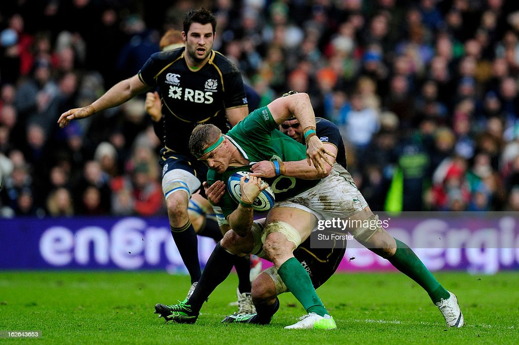 Ireland captain Jamie Heaslip is tackled by Kelly Brown of Scotland during the RBS Six Nations match between Scotland and Ireland at Murrayfield Stadium on February 24, 2013 in Edinburgh, Scotland.