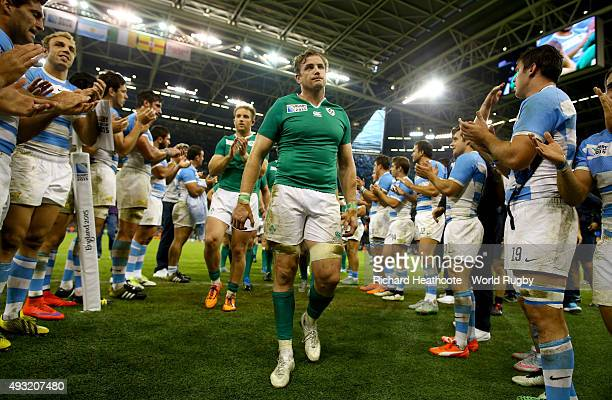 Ireland captain Jamie Heaslip leads his team off after losing the 2015 Rugby World Cup Quarter Final match between Ireland and Argentina at...