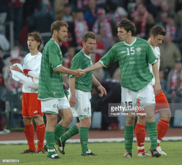 Ireland captain Kenny Cunnigham shakes hands with Jonathan Douglas at Stadion Zawiszky Bydgoszcz Poland during their international friendly