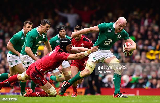 Ireland captain Paul O' Conell breaks the tackle of Luke Charteris during the RBS Six Nations match between Wales and Ireland at Millennium Stadium...