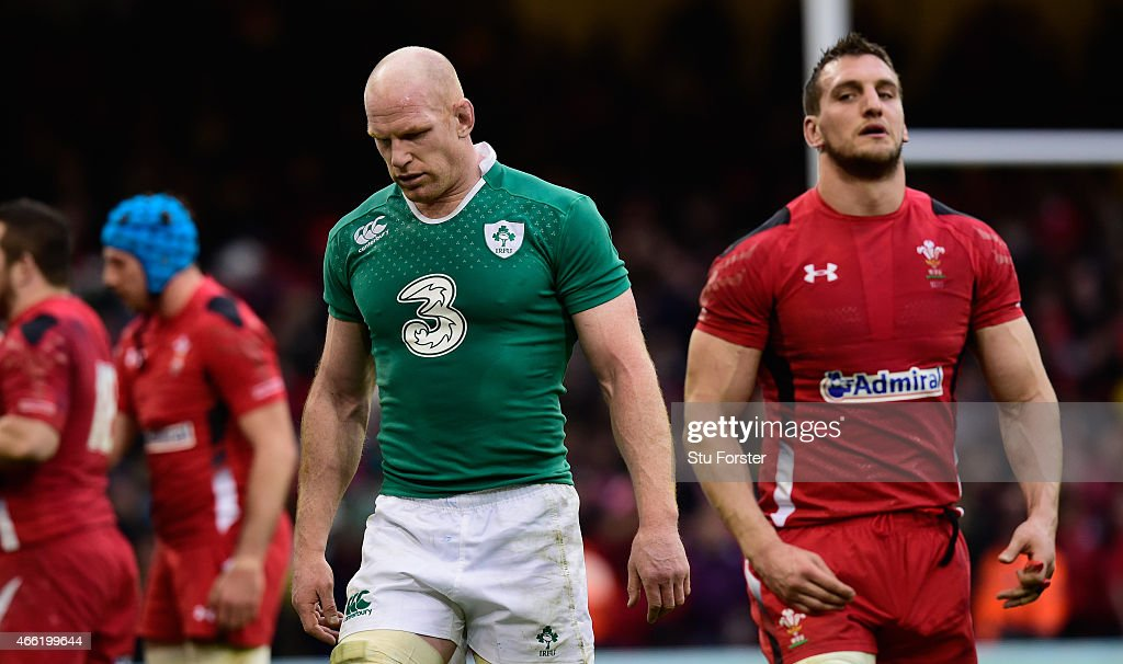 Ireland captain Paul O' Conell (l) leaves the field dejectedly as Wales captain Sam Warburton looks on after the RBS Six Nations match between Wales and Ireland at Millennium Stadium on March 14, 2015 in Cardiff, Wales.