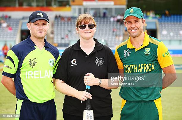 Ireland captain William Porterfield and South African captain AB De Villiers pose for photos with the Pepsi coin toss winner after the toss at the...
