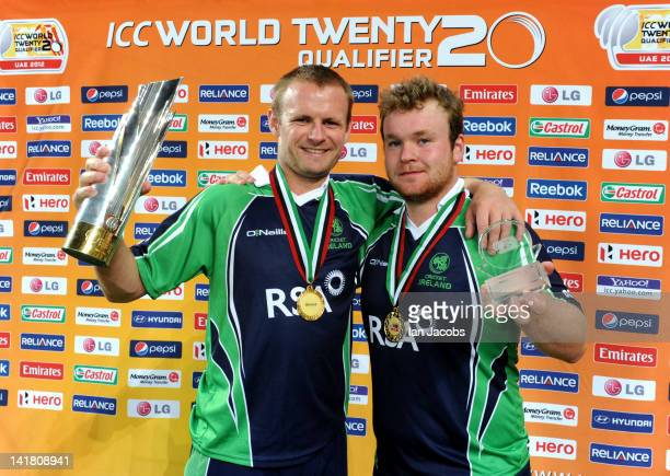 Ireland captain William Porterfield with player of the match Paul Stirling celebrate victory during the ICC World Twenty20 qualifier final between...