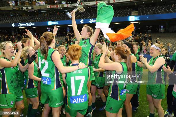 Ireland celebrate with the trophy after winning the 2017 International Cup Women's Grand Final match between Canada and Ireland at Etihad Stadium on...