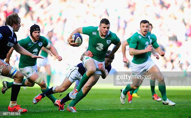 Ireland centre Robbie Henshaw makes a break during the RBS Six Nations match between Scotland and Ireland at Murrayfield Stadium on March 21 2015 in...